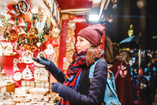 Woman Tourist Buys Souvenirs And Gifts At The Christmas Market In Prague