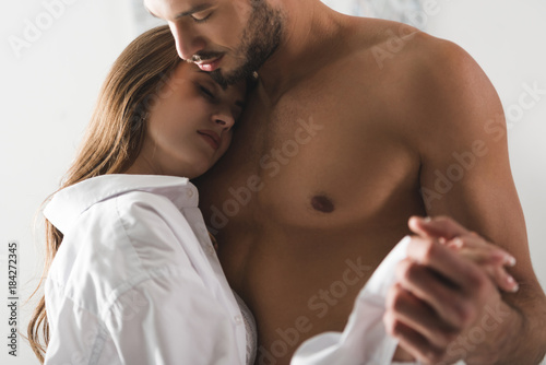 Fotografie, Obraz  close-up shot of attractive young couple dancing at home in morning