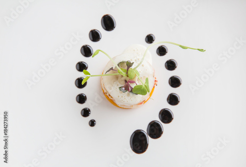 Haute high end cuisine gourmet appetizer shrimp, pear, pumpkin with butter foam