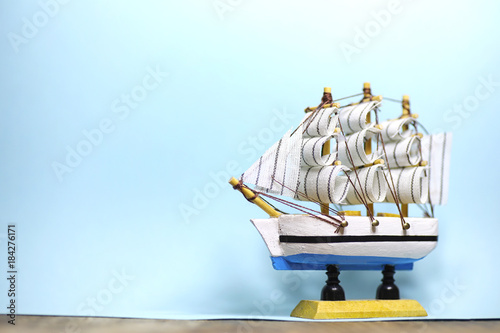 Keuken foto achterwand Schip Old wooden ship with sails and masts toy on a stand. Vintage and