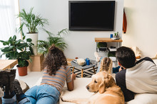 Teens Watching Tv And Lying On...