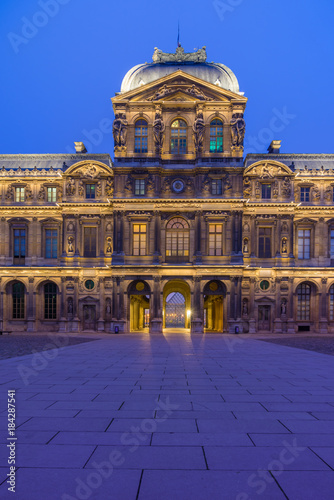 Valokuvatapetti iew of famous Louvre Museum with Louvre Pyramid at evening