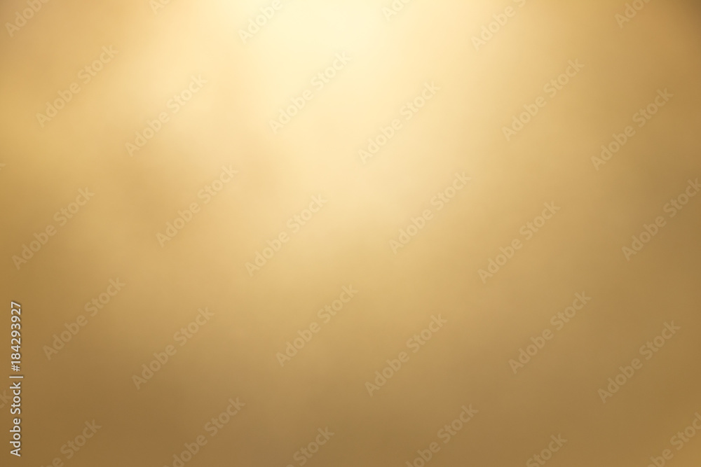 Fototapeta Gold color bokeh background. Decoration or backdrop for premium product, or christmas and new year festival