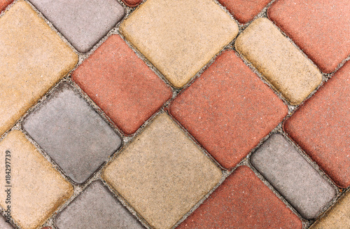 Beautiful coloured tiles in the yard  Paving slabs - Buy this stock