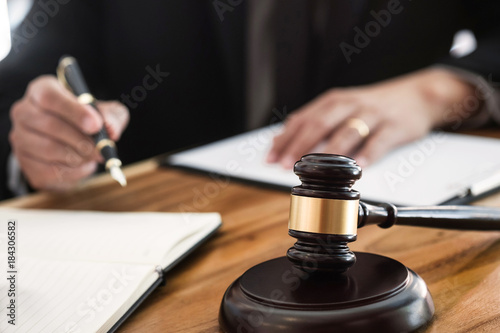 Obraz na plátně justice lawyer / judge gavel working with legal documents in a court room