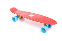 Red Plastic Skateboard On Whit...