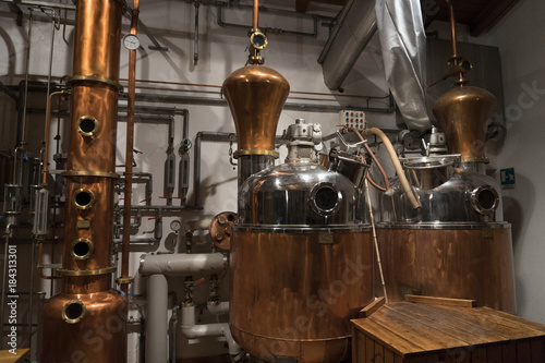 Photo Copper still alembic inside distillery