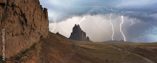 Photo Stands Deep brown A Violent Thunderstorm at Shiprock, New Mexico