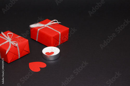 Fototapety, obrazy: Valentine's Day on the background of hearts, gifts and candles. On a black background. Top view, straight.