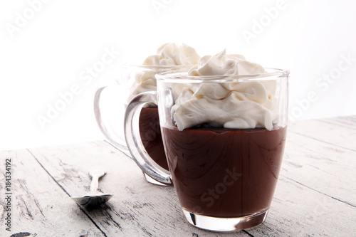 Foto op Plexiglas Chocolade Hot chocolate or coffee with whipped cream in glass.