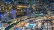 Seaside swimming pool in Monaco night timelapse, buildings in the background.