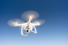 White Quadcopter Drone Flying ...