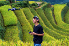 Photographer With Drone The Ri...
