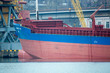 Vessel dry cargo on loading, unloading in port. Bulker in port.