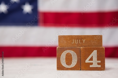 Photo  Date blocks arranged against American flag background