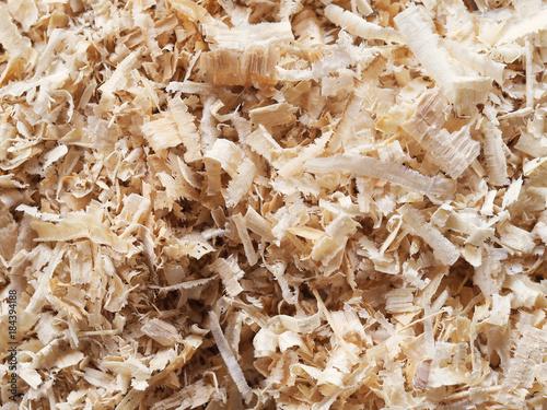 Fototapeta Heap of wood shavings, sawdust background