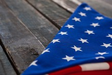 Folded American Flag On Wooden...