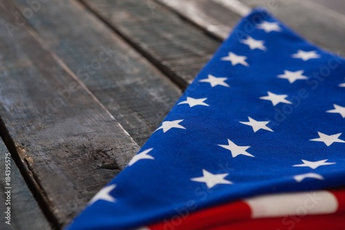 Photo  Folded American flag on wooden table