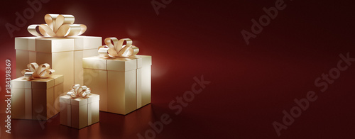 Fotografia  Pacchetti natalizi dorati su sfondo rosso