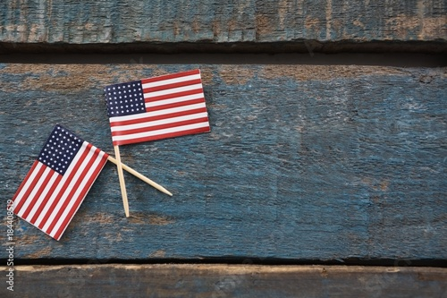 Two American flags on a wooden table Wallpaper Mural