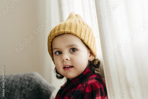 Cute girl posing in wool cap
