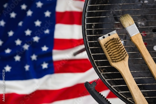 Photo  Basting brush arranged on barbeque against American flag