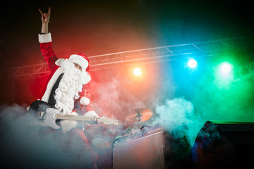 Santa Claus plays rock.