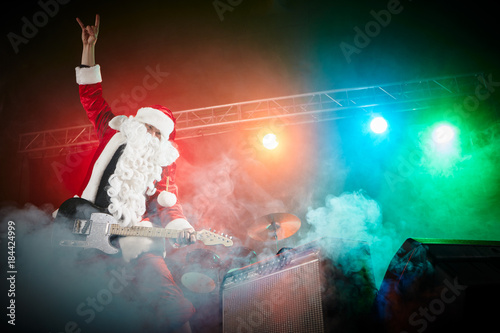 Fotobehang Voetbal Santa Claus plays rock.