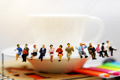 Fotografie, Obraz  Miniature people: business team  sitting on cup of coffee,  break time of business concept