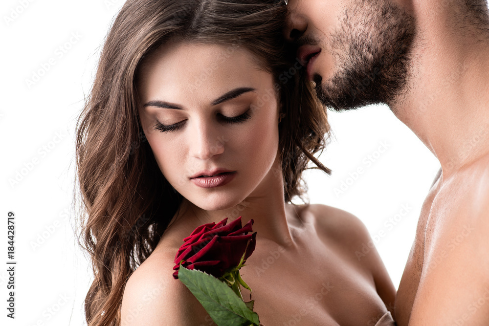 Fototapeta acctractive sensual couple with rose isolated on white
