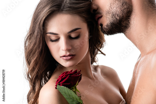 acctractive sensual couple with rose isolated on white Fototapeta