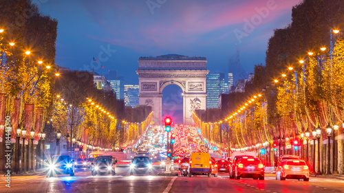 Valokuva  Famous Champs-Elysees and Arc de Triomphe at twilight in Paris