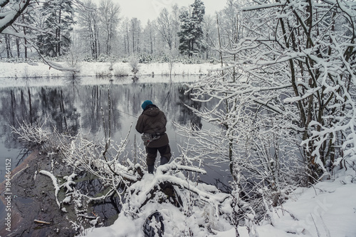 Foto op Aluminium Fantasie Landschap Fisherman is fishing on the winter river.