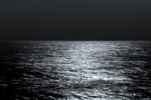 Sea Horizon At Night. Moonlight On The Waves. Long Exposure. Beautiful Landscape. Black And White Toning