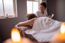 Female Massage Therapist Talki...