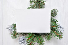 Mockup Christmas Greeting Card With Tree And Cone, Flatlay On A White Wooden Background, With Place For Your Text