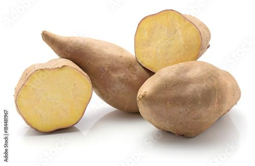 Carta da parati Sweet potato isolated on white background two whole two halves raw
