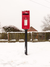 Red Village Post Box Outside S...