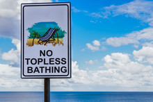 "Sign In Sliema, Malta, Warning Sunbathing That No Topless Bathing Is Permitted, But Which Has Had The Word ""No"" Covered Over."