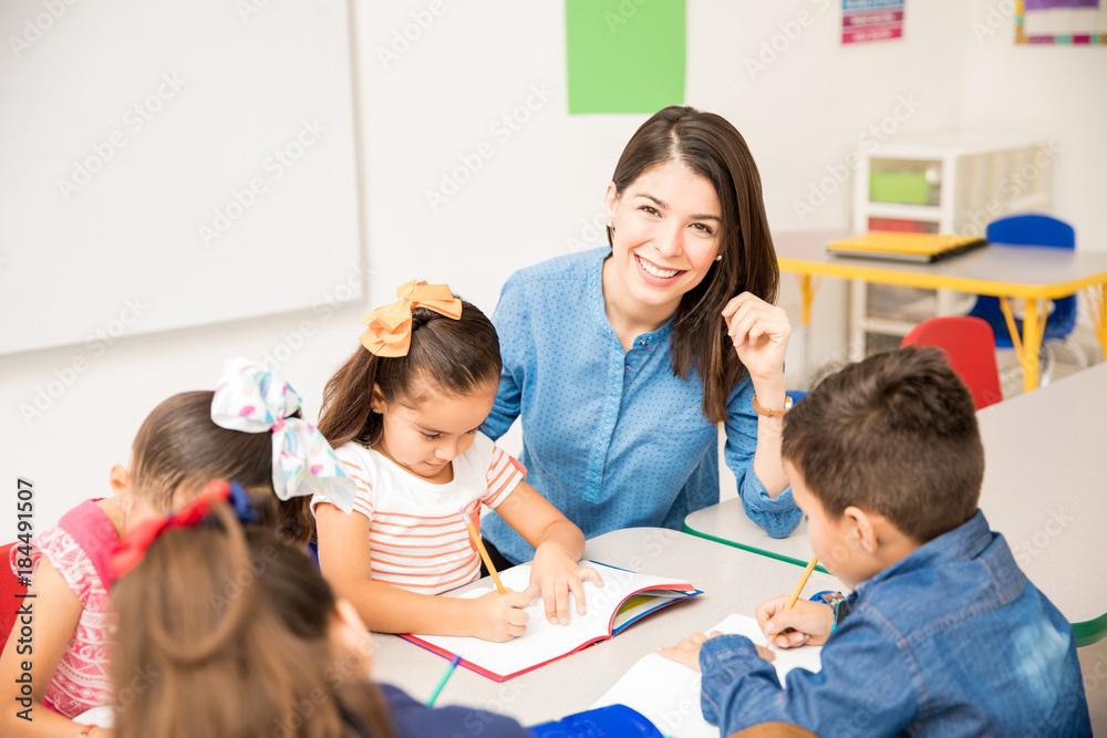 Fototapeta Beautiful preschool teacher during class