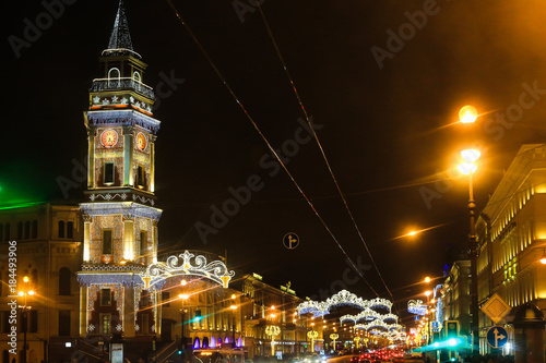 Fototapeta Street decoration to Christmas. City is decorated to New Year. Winter holidays in St. Petersburg, Russia..Nevsky Prospect illuminated for Christmas. obraz na płótnie