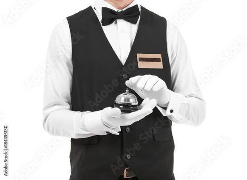 Fotomural Handsome bellboy on white background, closeup