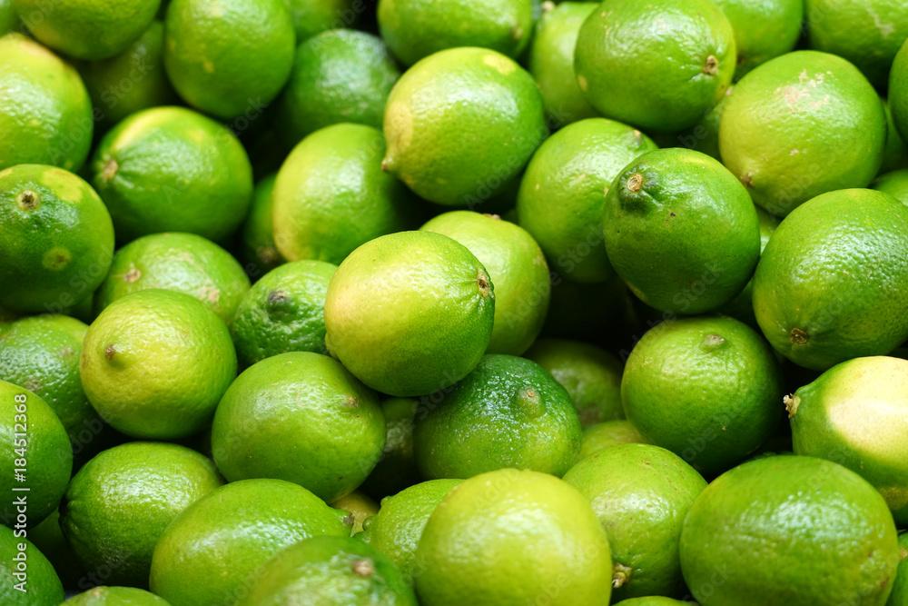 Fototapeta Fresh green lime pile in harvest season