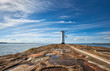 Seawall and historic lighthouse in Swinoujscie, Poland