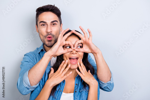 Woman holding a mans face in her hands