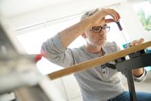 Man At Home Assembling DIY Fur...