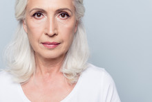 Close Up Portrait  Of Nice, Charming, Aged, Concentrated, Woman With Serious Expression, Treatmnet With Dark Spots, Standing Over Grey Background