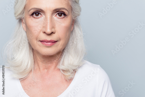 Canvastavla  Close up portrait  of nice, charming, aged, concentrated, woman with serious ex
