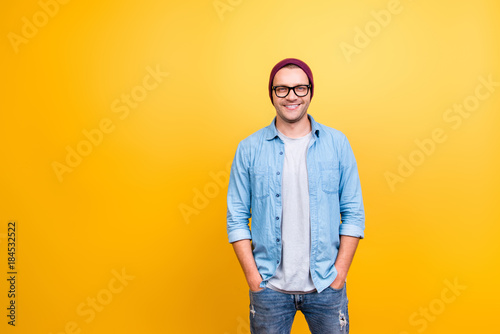 Carta da parati  Portrait with copy space of smiling, happy guy in jeans wear, glasses, red cap h