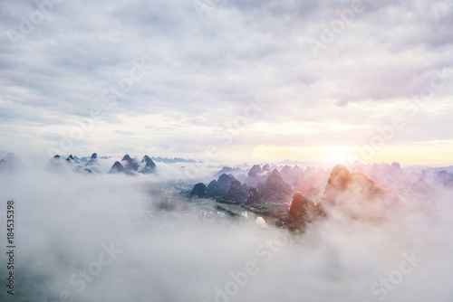Garden Poster Beautiful layers of tropical mountain range landscape with winter sky from top view in majestic fog of winter.